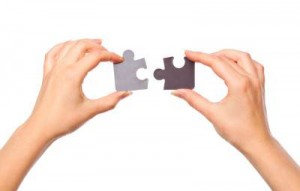 helping-hands w puzzle pieces